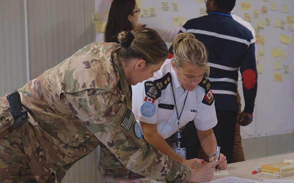 Two women in uniform working on CPAS