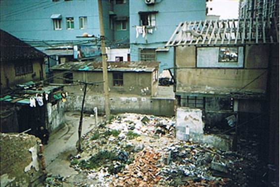 The view from Mr Hu's balcony. This used to be his neighbour's house. Mr Hu: 'They started demolition in 2004. Most of the neighbours have moved away. Garbage is all over the place now. Nobody takes care of it. It is hard to keep the dog from eating garbage'. Photograph: Mr Hu, April 2007