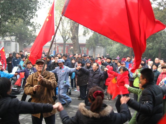 A choir celebrates Mao Zedong's forthcoming birth day. The north-western corner of the park has become known as the Speakers' Corner, where Maoist groups gather on Sundays ((4 December 2011; Photographed by Lisa Richaud).