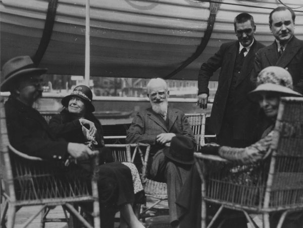 Charlotte and George Bernard Shaw seated centre, the Webbs seated either side. Leaving for a trip to Russia. IMAGELIBRARY/68. LSE