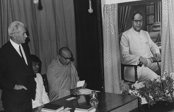 Presentation of portrait of Dr B.R. Ambedkar by the Dr Ambedkar Memorial Committee, Great Britain, 25 September 1973. Left to right: Sir Walter Adams, Mr D.R. Jassal (Chairman Ambedkar Memorial Committee), Ven Dr H. Saddatissa (Head of London Buddha Vihara). IMAGELIBRARY/651. LSE