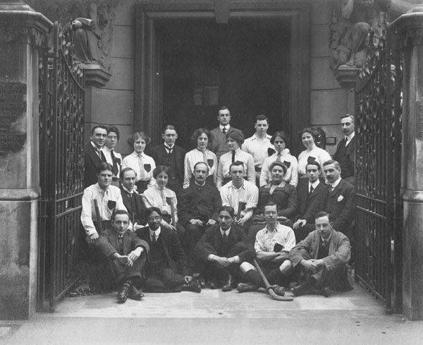 First LSE hockey team, 1911. Standing extreme left Percy Anstey, 6th from left, Margery Holman, seated from left Percy Holman, H.B. Lees-Smith, Vera Powell (later Anstey), William Pember Reeves (Director), front second from left N.M. Mazwundar (President of the Students Union).. IMAGELIBRARY/1316. LSE