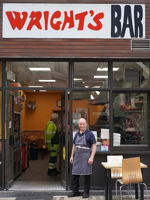 Wright's Bar manager Antonio stands outside the popular café adjacent to the LSE Old Buildingentrance.