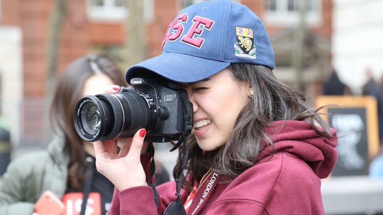 LSE student holding camera