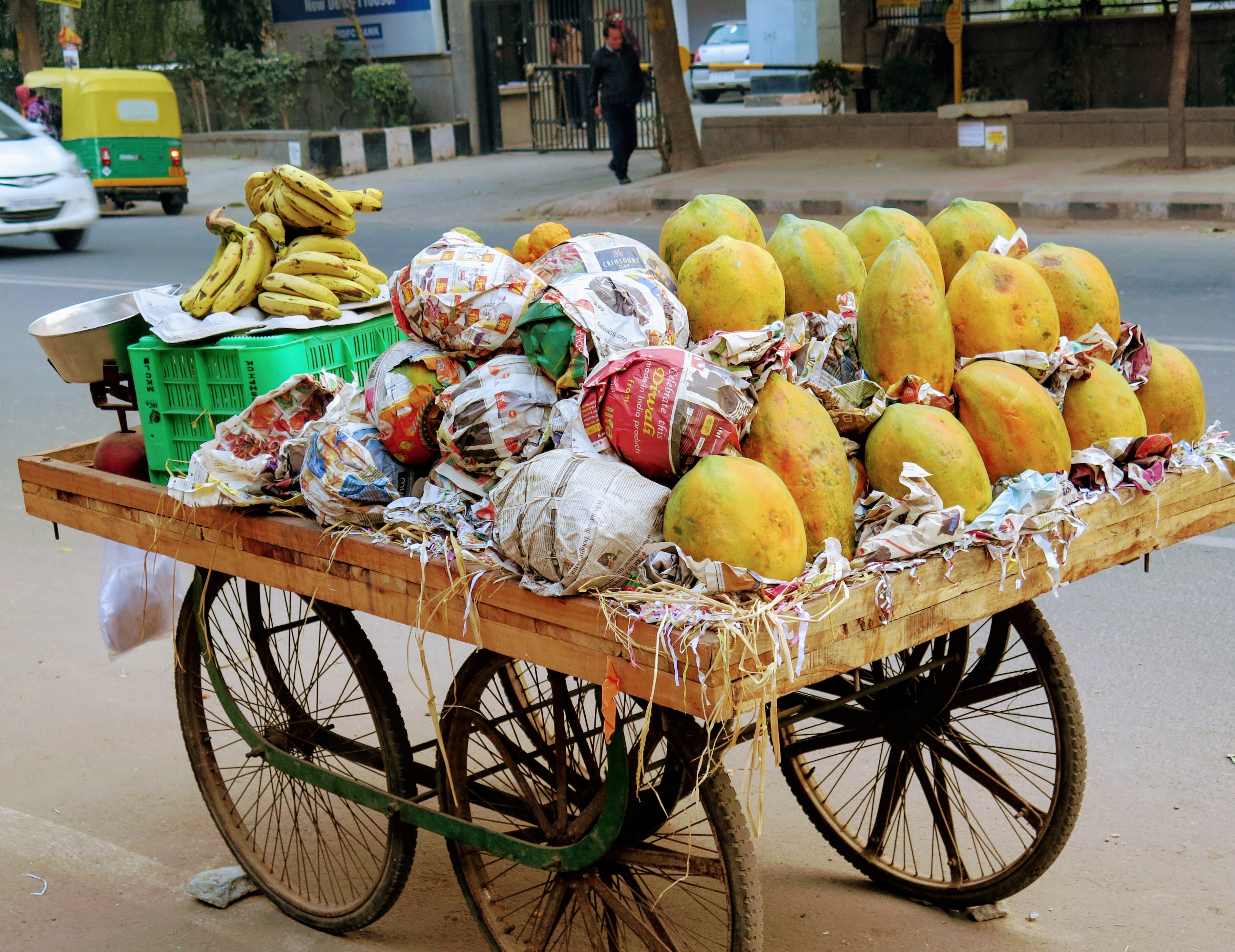indian street cart with a selction of fruits